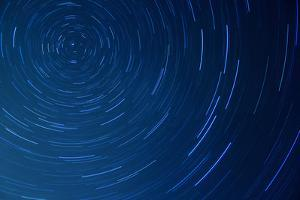 Time-Lapse Photo of Stars Rotating in a Night Sky by oriontrail2