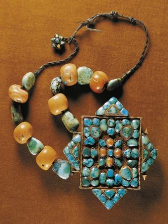 https://imgc.allpostersimages.com/img/posters/ornament-for-carrying-gau-talisman-silver-gilt-bezels-with-coral-and-turquoise-region-of-tibet_u-L-POPUY70.jpg?p=0