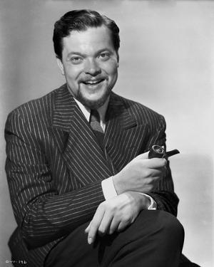 Orson Welles smiling in Black and White by E Bachrach