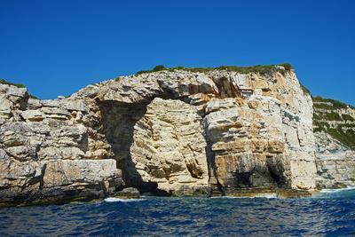 https://imgc.allpostersimages.com/img/posters/ortholithos-rock-paxos-paxi-ionian-islands-greek-islands-greece-euruope_u-L-PQ8Q7Z0.jpg?p=0