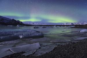 Aurora Borealis Over Fjallsjokull And Fjallsarlon. Vatnajokull National Park. Iceland by Oscar Dominguez