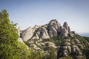 Rock Formations Of Montserrat Natural Park. Barcelona Province. Catalonia. Spain by Oscar Dominguez
