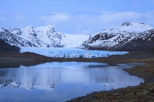 View Of Svinafellsjokull Glacier At Sunset. Vatnajokull National Park. Iceland by Oscar Dominguez