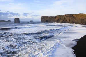Waves Washing Over Black Beach At The Vik Coastline Looking Toward Dyrholaey. Vik. Iceland by Oscar Dominguez
