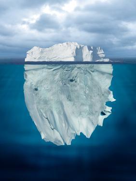Mostly Underwater Iceberg Floating in Ocean by Oskari Porkka