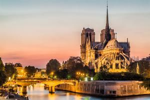 Notre Dame De Paris by Night and the Seine River France in the City of Paris in France by OSTILL