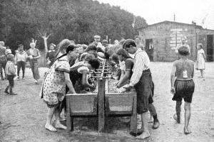 Washing-Up at a Juvenile Summer Holiday Camp, Germany, 1922 by Otto Haeckel