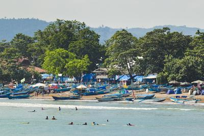 https://imgc.allpostersimages.com/img/posters/outrigger-fishing-boats-at-the-town-beach-of-this-major-south-coast-resort_u-L-PQ8M8B0.jpg?p=0