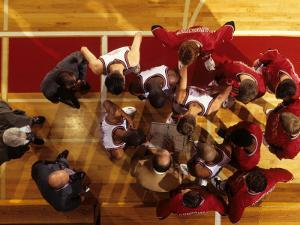 Overhead View of Coach Instructing High School Basketball Team