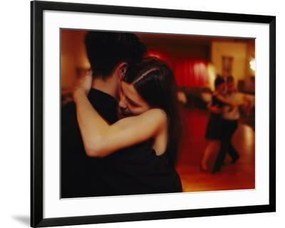 A couple tango in a loving embrace