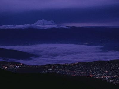 Cloud-Shrouded Mount Antisana Rises Above Quito