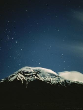 Clouds Hug the Top of Snow-Capped Mount Chimborazo, Ecuador by Pablo Corral Vega