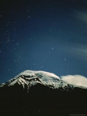 Clouds Hug the Top of Snow-Capped Mount Chimborazo, Ecuador by Pablo Corral Vega
