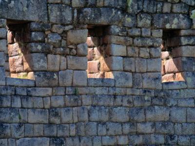 Sunlight Filters Through Stone Windows at Machu Picchu