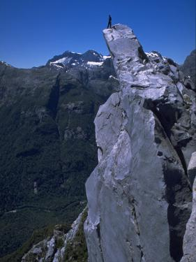 Climber on the Summit of a Rock Tower, Chile by Pablo Sandor