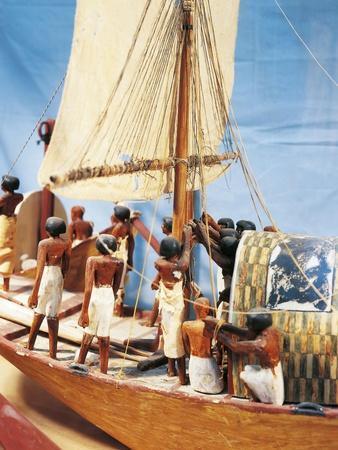 https://imgc.allpostersimages.com/img/posters/painted-wood-model-boat_u-L-POPRSR0.jpg?artPerspective=n