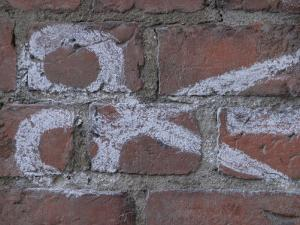 Painting of Scissors on Rustic Brick Wall