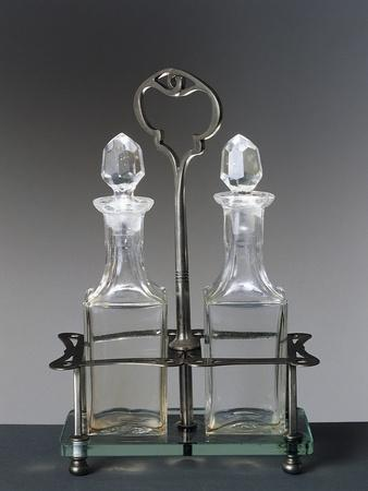 https://imgc.allpostersimages.com/img/posters/pair-of-glass-cruets-for-oil-and-vinegar-with-metal-stand-italy_u-L-POP5Q30.jpg?p=0