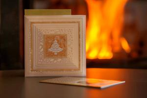 Christmas cards, fireplace with fire on background by Paivi Vikstrom