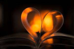 Heart, bokeh fire, dark background by Paivi Vikstrom