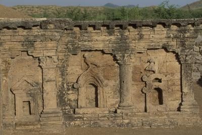 https://imgc.allpostersimages.com/img/posters/pakistan-taxila-view-of-stupa-of-two-headed-eagle-of-ancient-sirkap-archaeological-area_u-L-PQ2T1O0.jpg?p=0
