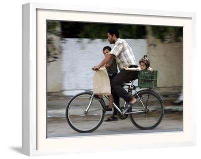 Palestinian Man, 28, Takes His Son, 4, and Daughter, 2, on His Bicycle