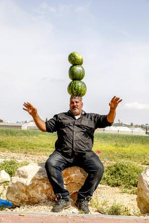 https://imgc.allpostersimages.com/img/posters/palestinian-selling-watermelons-at-al-jalameh-checkpoint-on-israel-palestine-border-palestine_u-L-Q1GYJ1E0.jpg?artPerspective=n