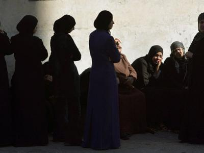 Palestinian Women Sit as They Mourn During the Funeral of Four Al-Aqsa Martyrs' Brigades Militants