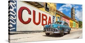 Vintage car and mural, Cuba by Pangea Images