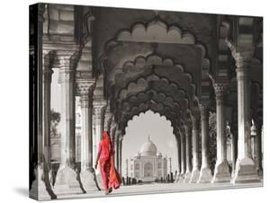 Woman in traditional Sari walking towards Taj Mahal (BW) by Pangea Images