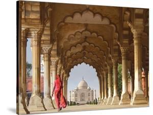 Woman in traditional Sari walking towards Taj Mahal by Pangea Images