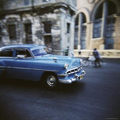 https://imgc.allpostersimages.com/img/posters/panned-shot-of-an-old-blue-american-car-havana-cuba-west-indies-central-america_u-L-P2QSX90.jpg?p=0