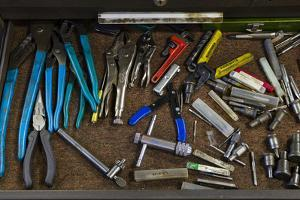 An open toolbox drawer filled with various handtools by Panoramic Images