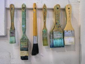Close-up of paint brushes hanging on wall at an artist studio, California, USA by Panoramic Images