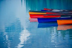 Colorful rowboats reflection, Banff, Alberta, Canada by Panoramic Images