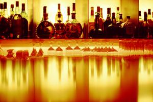 Liquor bottles and glasses, Paris, France by Panoramic Images