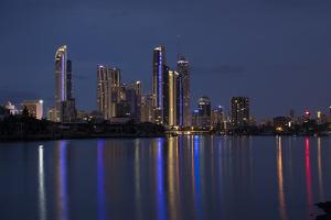 Reflection of illuminated skylines on water, Coral Sea, Surfer's Paradise, Gold Coast, Queenslan... by Panoramic Images
