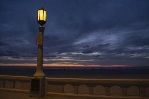 Street lamp against dramatic sky at dusk, Seaside, Oregon, USA by Panoramic Images
