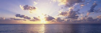 Sunset over the sea, Seven Mile Beach, Grand Cayman, Cayman Islands by Panoramic Images
