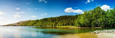 https://imgc.allpostersimages.com/img/posters/panoramic-long-exposure-shot-of-a-lake-in-northern-norway_u-L-Q105F4R0.jpg?artPerspective=n