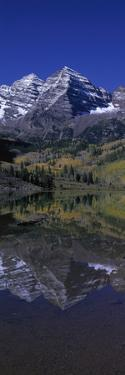 Panoramic View of Autumn Colors of Aspens Reflecting in Lake under Maroon Bells