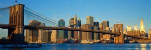 Panoramic View of Brooklyn Bridge and East River at Sunrise with New York City