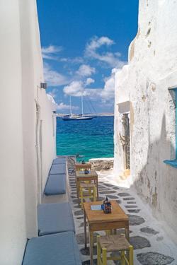 Traditional Greek Alley on Mykonos Island, Greece by papadimitriou