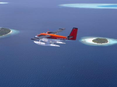 Aerial View of Maldivian Air Taxi Flying Above Islands in the Maldives, Indian Ocean