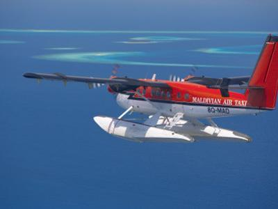Aerial View of Maldivian Air Taxi Flying in the Maldives Archipelago, Indian Ocean