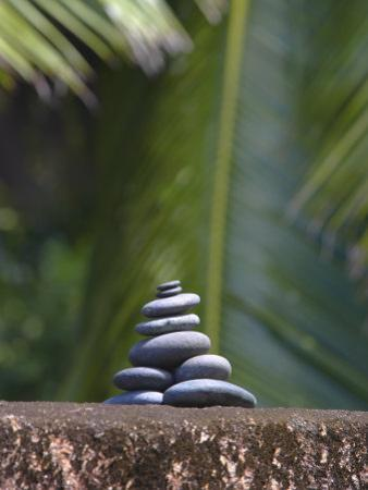 Stones Balanced on Rock, Palm Trees in Background, Maldives, Indian Ocean