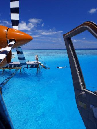 View from a Seaplane Cockpit of Man Swimming, Maldives, Indian Ocean