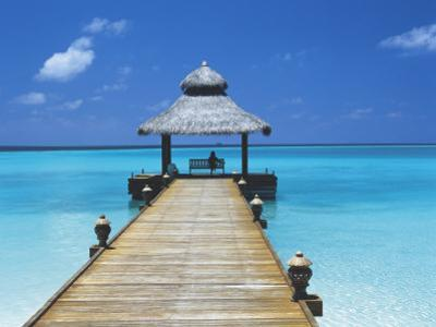 Young Woman Sitting on Bench at the End of Jetty, Maldives, Indian Ocean