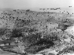 Parachutes are Dropped from C-47 Planes