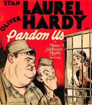 PARDON US, from left: Oliver Hardy, Stan Laurel on window card, 1931.